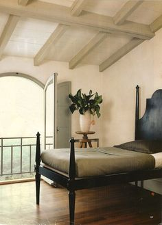 Reed Interiors - the 4-poster, the arched doors, the beams...all