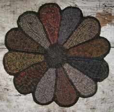 """This is the latest rug to come off my frame and is my own design. """"Primitive Flower Round"""" Measures approx. 17"""" round Hooked ..."""