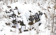 US Marines and South Korean Marine Corps soldiers take up positions in a snowy field during a winter exercise in Pyeongchang, some 200 kilometers east of Seoul, South Korea.