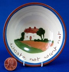 This is a Dartmouth Pottery, Torquay England mottoware or motto ware bowl or dish made 1940-1950s. The traditional cottage design mottoware bowl or dish has the motto Waste Not Want Not.