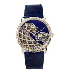 La montre Métiers d'Art Ronde Louis Cartier XL panthère filigrane de Cartier SIHH 2015 http://www.vogue.fr/joaillerie/le-bijou-du-jour/diaporama/la-montre-metiers-d-art-ronde-louis-cartier-xl-panthere-filigrane-de-cartier-sihh-2015/21316