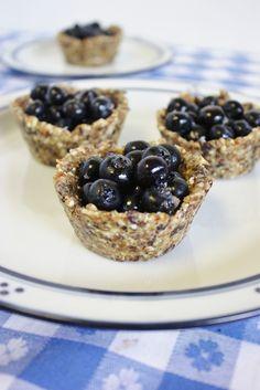 Raw blueberry tarts.