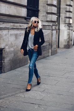 Match denim jeans with a blazer to get this effortlessly chic style which Lucy Connelly is rocking. She pairs a navy blazer with a grey V neck and jeans to create this look. Brands not specified.