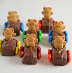 Teddy Bear Race Cars  So simple... fun size Milky Ways, Teddy Grahams and M  I melted a few chocolate chips to use as glue for attaching the M wheels to the Milky Way car. I made sure each car had all the same color wheels, and I made sure all the Teddy Grahams were the same shape. To put the Teddy Grahams into the Milky Way, I first cut a little slit before pushing them in. Reason being, the first one that I did (without the slit) caused the candy bar to get slightly crushed from the…