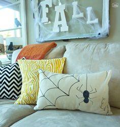 Halloween House Tour Living Room EEK DIY dropcloth pillow at thehappyhousie  #Halloween decorating