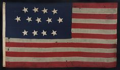 ENTIRELY HAND-SEWN, 13 STAR, U.S. NAVY SMALL BOAT ENSIGN , MADE SOMETIME BETWEEN 1850 AND THE OPENING YEARS OF THE CIVIL WAR