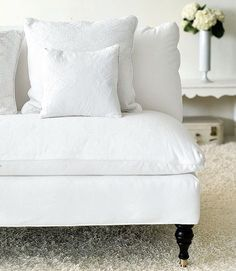 Apply fabric protection treatments, like Scotchgard, to your white upholstery to prevent stains from setting, . To hide small stains, be sneaky, and accessorize with other textiles. In the event of a spill, Turnbow suggests you spot clean with cornstarch, salt, or commercial stain removers. Note: Always test your stain removal method in an inconspicuous spot before attacking a visible area. If in doubt, call a professional upholstery cleaner to assess the situation.   - CountryLiving.com
