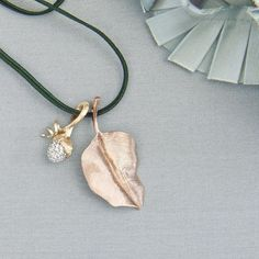 A hand-engraved leaf combined with a Lotus diamond pendant #finejewellery #olelynggaardcopenhagen #charlottelynggaard #olelynggaard @charlottelynggaard_dk