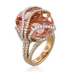 What a showstopping piece this Yael Designs ring is! This beauty has a 25.73ct Morganite center stone and 1.20ctw in diamonds, set in 18K Rose Gold.