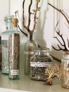 Give your sand collection a makeover with an elegant twist. Portion out your sand into antique jars and label each one with the location and date. Layer in coral and dried sea plants for an ocean-inspired scene.