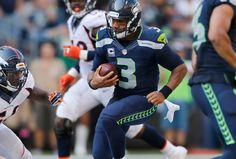 Seahawks quarterback Russell Wilson gave reporters a glimpse of exactly what goes down at the bottom of an NFL scrum.