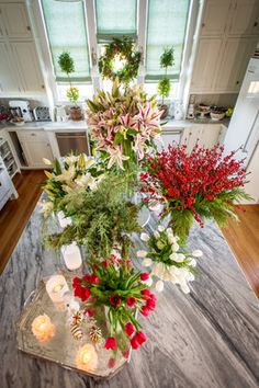 A cheery arrangement of flowers, perfect for Christmas time. The flowers add a splash of color and warmth to the room. For more tips about decorating for the holidays with flowers from TV host/gardening expert P. Allen Smith:  https://www.stargazerbarn.com/blog/holiday-flower-decorating-tips-p-allen-smith