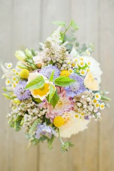 romantic purple and yellow bouquet of chamomile, scabiosa, dahlias and craspedia | floral design: Bare Root Flora | photo: brumleyandwells.com