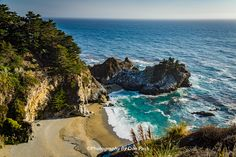 Big Sur McWay Falls - McWay Falls from the Pacific Coast Highway.  McWay Falls is one of the most unique and majestic sights along the California's coastline. The 80-foot waterfall is located in Julia Pfeiffer Burns State Park in Big Sur and runs year-round. This rare fresh waterfall tumbles down a steep granite cliff into a picturesque cove and directly into the Pacific Ocean.   Big Sur scenic drive is a must, if you want to see the real beauty of the California coastline.