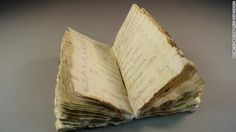 A century-old notebook has been discovered in the ice at one of Robert Scott's expedition base in Antarctica.