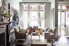 This 5,000-square-foot historic Harlem brownstone home is designed by Sheila Bridges for a...