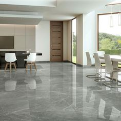 granite flooring Subtle light veining on a polished grey background create a very minimal appearance in both contemporary and traditional applications.Available in a range of sizes Displays of this tile can be seen in our showrooms Grey Marble Floor, Living Room Tiles, Marble Flooring Design, Grey Flooring, Granite Flooring, House Tiles, House Flooring, Marble Living Room Floor, Marble Porcelain Tile