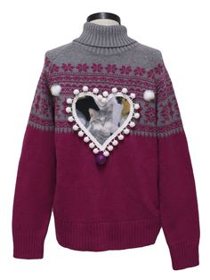 Studio Works Unisex Ugly Catmus Christmas Sweater 80s style -Studio Works- Love your cat more than life itself? Wear this unisex fuschia background acrylic cotton blend pullover longsleeve Ugly Catmus Christmas Sweater in commemoration. Grey ribbed turtleneck collar with grey and fuschia snowflake pattern around yoke and sleeves. Decorated with a centered heart-shaped patch of a precious grey tabby kitten with glittery eyes.