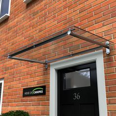 High quality door canopy designed and hand made in the UKSteel poles support straight rails with thick UV stable clear Polycarbonate sheet secured with ... & glass canopy entry - Google Search | glass canopies | Pinterest ...
