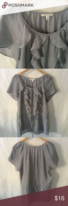 Ruffled Gray Banana Republic Blouse This sweet gray top has a ruffles from the neckline down to the tie waist. Semi-sheer, I was always more comfortable with a family underneath but you wouldn't have to. EUC, worn less than a handful of times. Banana Republic Tops Blouses