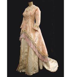 House of Worth, Dress of Brocaded Silk Damask with Hand-Knotted Pink Silk Fringe.