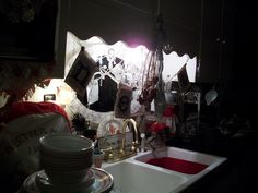 Kitchen sink w/my little chandelier and various junk I like :).