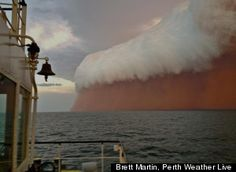 """An intense dust storm in Western Australia allegedly led to the creation of a """"red wave"""" off the coast of Onslow."""