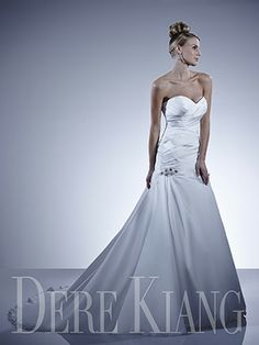Strapless sweetheart neckline, with gathered dropped bodice. Beaded detail at hip. Laceup Back. Satin Faced Chiffon