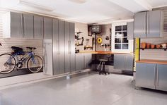 Garage workshop fulfills all your dreams of an organized with workbenches, slatwall, storage shelves, storage cabinets, and special flooring to enjoy your hobbies. Garage Floor Paint, Garage Walls, Garage House, Garage Shop, Dream Garage, Garage Storage Solutions, Garage Organization, Organized Garage, Cheap Garage Cabinets