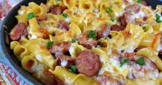 One-Pot Spicy Sausage Skillet - smoked sausage, chicken broth, cream, pasta, rotel, cheese and green onions. Everything cooks in the same skillet, even the pasta! Quick recipe! Ready in 15 minutes! My husband asked for this 3 days in a row!