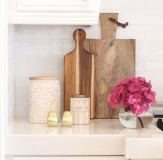 Today we want to share some of our tips on styling a kitchen. First, we start with a crisp neutral palette. Once we have created a fresh new look in a kitchen, we finish with the styling. This is where we add the warmth and personality to the space. Here are a few of our favorite tips for styling a kitchen: We like to use cutting boards. They are useful and eye candy at the same time. Fresh flowers and a plant add bring life to a kitchen. Visit the blog to see more of our tips on how to…