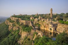 fr/Getty Images Chittorgarh Fort, India One of the largest forts in India, Chittorgarh has amazing views, incredible ruins, and tons of history. Tourist Places, Places To Travel, Places To See, Travel Destinations, Chittorgarh Fort, Beautiful Castles, Beautiful Buildings, Ancient Architecture, India Architecture