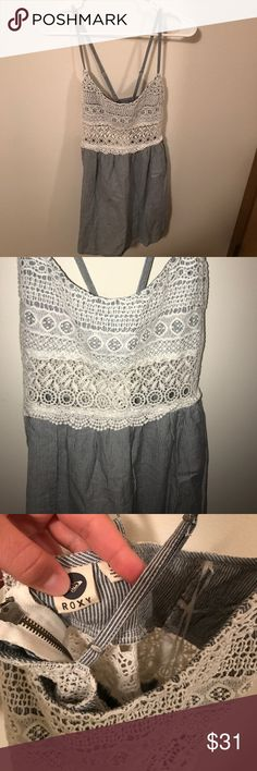Dress Roxy dress. Zip up in the back. Lace in the front. Roxy Dresses