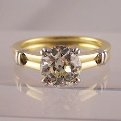 Old cut diamond in yellow gold with platinum shoulder detail