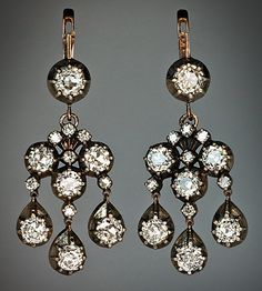 Antique Style  Chandelier / Girandole Earrings These finely handcrafted Russian earrings are embellished with 28 sparkling old European and old mine cut diamonds. The diamonds are set in silver over rose gold.