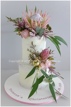 Very elegant semi naked girl's Christening cake decorated with beautiful Australian native flowers