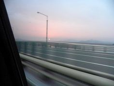 Sunset over South Korea near the Incheon Airport - (photographed from a moving car)