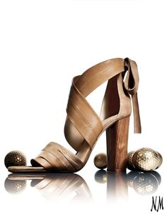 Step into fall with suede sandals by Vince. Pair with a sheath dress and tan handbag for the office and happy hour.