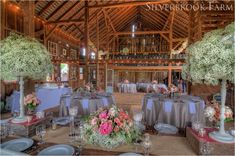 EXACTLY what I want my barn wedding to look like.  Minus the fussy tablecloths, baby's breath overload, and 80's flowers ;)