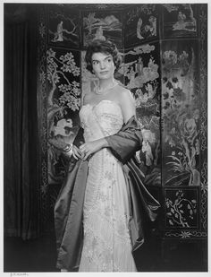 Jackie Kennedy in a sweetheart strapless gown with florals  gathers..... contrasting satin long stole...