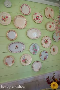 Pink floral plates on green wall I have a row of plates predominant floral is pink so I'm thinking of painting this small strip of wall green behind these plates.