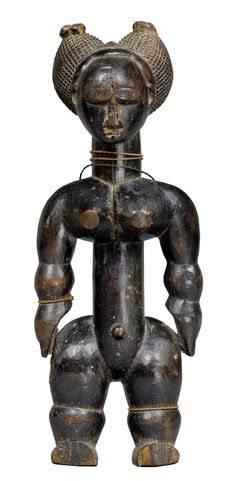 Africa | Female statuette from the Akyé people of the Ivory Coast | Wood, natural fiber.  H: 26 cm