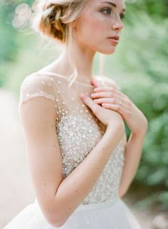 Like the beaded detail on top and invisible neckline. Possibly too formal for beach wedding?