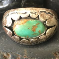 Navajo old Pawn Henry Mariano turquoise Sterling r Beautiful patina very old Navajo signed HM Henry Mariano turquoise old pawn ring.  This ring is size 9 and features a beautiful turquoise oval stone that is shadow boxed with curved design and is accented with Navajo tribal designs around the outside of ring.  Absolutely beautiful patina if you like it that way if not it can be cleaned.  Leave that up to buyer. Vintage Jewelry Rings