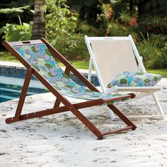 Sling Outdoor Wood Lounge Chair | Solid acacia frame in white or chestnut.