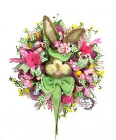 Deco Mesh Easter Bunny Wreath w Large Bunny Head, spring flowers and Easter eggs by www.southerncharmwreaths.com
