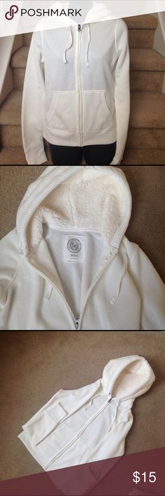 NWT-Cozy off white hoodie Warm & cozy hoodie by SO.  Body is 100% polyester.  Faux fur in good is also 100% polyester. Jackets & Coats