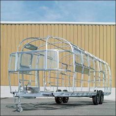 Using techniques common in aircraft manufacturing gave Airstream trailers a high strength-to-weight ratio. Hand-built aluminum ribs are formed into a support 'cage' for the exterior skin, a technique still used in today's trailers.