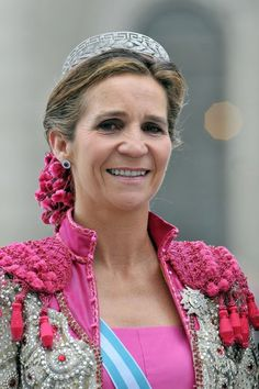 Spanish princess prepares to challenge the bull in the ring with hope that the sparkle of her tiara will distract it.