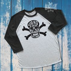 Yo ho, yo ho, a pirates life for me! We may not pillage, plunder, rifle or loot, but we will look good in this pirate-inspired, hand-lettered design! Perfect for a meeting with Jack Sparrow, for Pirate Night aboard a Disney cruise, or to complete your Halloween pirate costume. Drink up me earties, yo ho!  Stylish 2-color baseball tee is pictured in Vintage Black/Heather White, but refer to our Color Guide to customize your selection. Design will be made in black vinyl unless otherwise re...